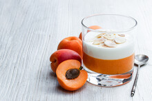 Layered Dessert In Glass With Apricot Jelly With Vanilla Mousse