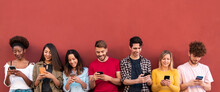 Young People Using Mobile Phones - Millennial Friends Having Fun With New 5g Technology Trends - Tech And Lifestyle Concept - Main Focus On Center Faces