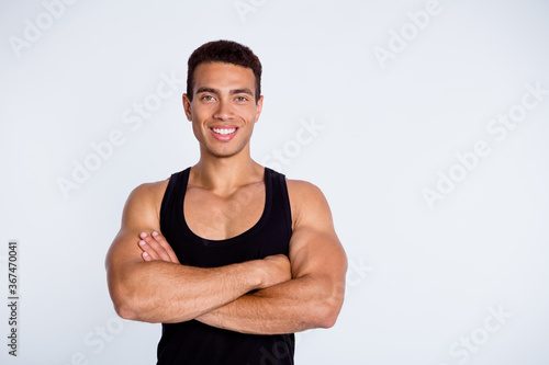 Obraz Close-up portrait of his he nice attractive content sportive virile muscular cheerful cheery guy champion goal championship winner folded arms isolated over gray pastel color background - fototapety do salonu