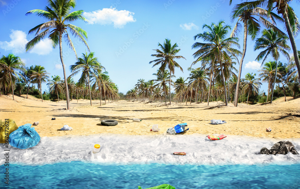 Fototapeta Pollution concept. Garbages, plastic, and wastes on the sandy beach of tropical sea. Ecological problem.