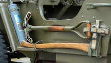 Detail Of Different Work Tools On The Side Of Military Vehicle. Shovel, Axe