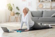 Online Yoga. Senior Woman Stan...