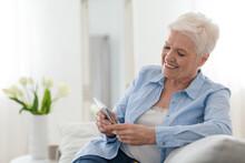 Happy Elderly Lady Using Mobil...
