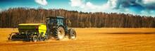 Farmer With Tractor Seeding - ...