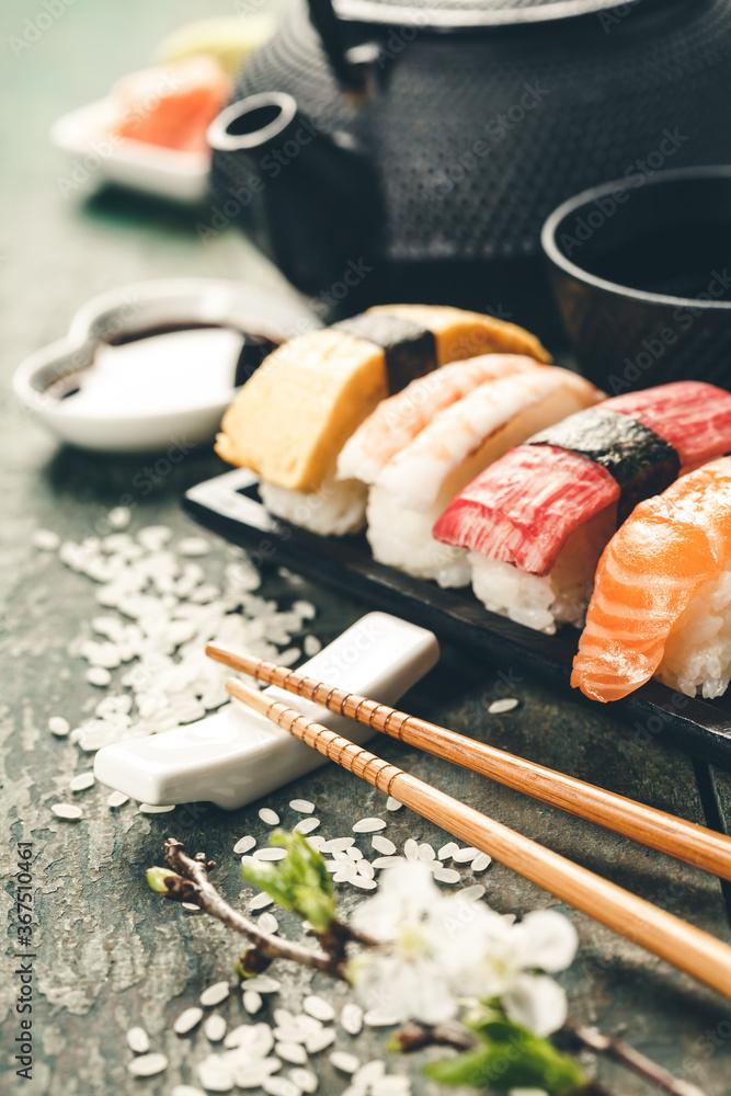 Fototapeta Closeup of fresh sushi on rustic wooden table