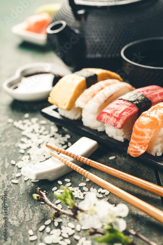 Obraz Closeup of fresh sushi on rustic wooden table - fototapety do salonu