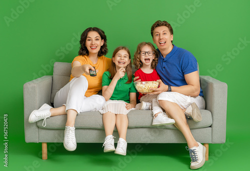 Happy loving family on bright color background. - 367520478