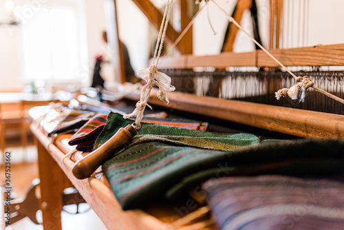 Slika na platnu Close up of gold silk weaving on loom, cotton on the manual wood loom in Asian t