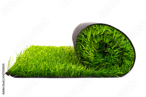 Fotografía artificial turf roll of green grass isolated on white background