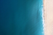 Aerial View Of Beautiful Sea And Sandy Beach On Sunny Day