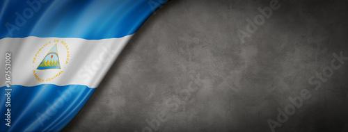 Fotografía Nicaragua flag on concrete wall banner