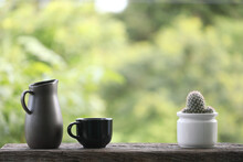 Teapot With Black Cup With Cac...