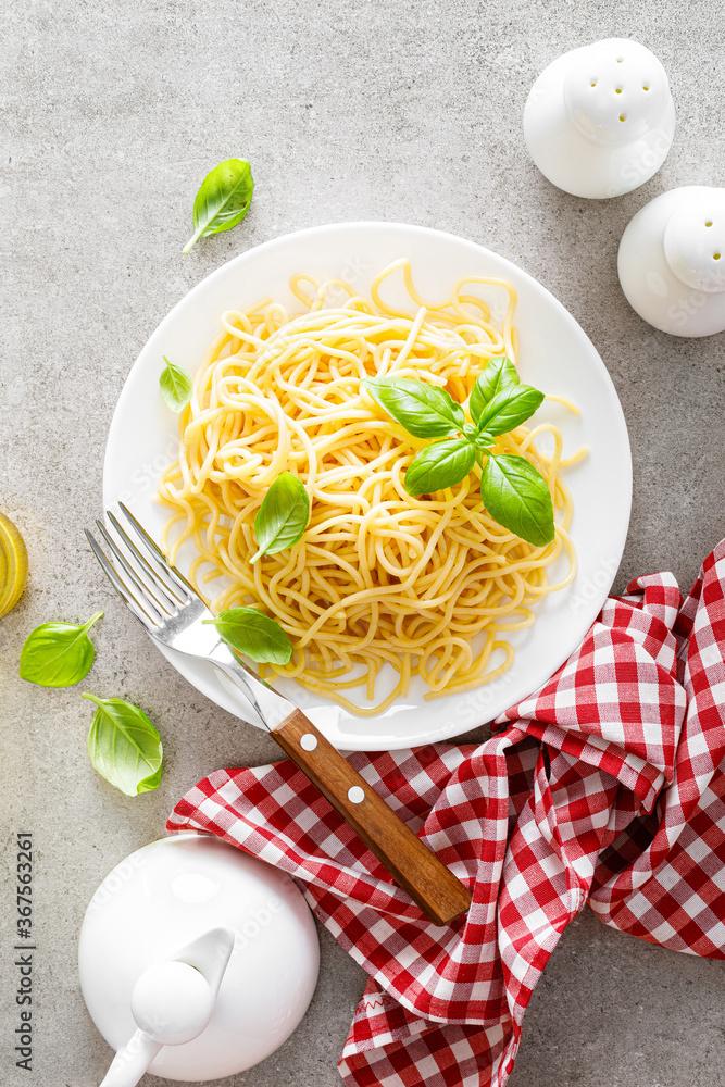 Fototapeta Pasta. Traditional italian food. Vermicelli with fresh basil