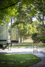 Moving Truck With Lift Gate - Older Refrigerator Sitting On It And Dolly Nearby -  In Leafy Green Neighborhood Selective Focus