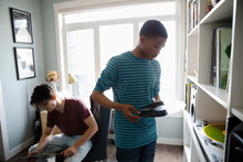 Teenage Boys Listening To Records In Home Office