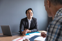 Smiling Financial Advisor Meeting With Man In Office