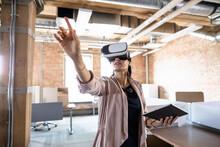 Businesswoman Using VR Simulat...