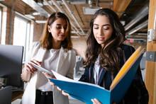 Businesswomen Discussing Paper...