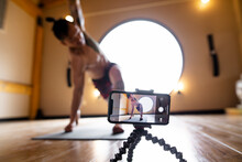 Male Yoga Instructor Filming C...