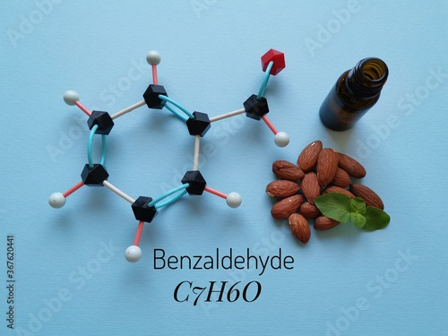 Molecular structure model of benzaldehyde molecule with almond oil Canvas Print