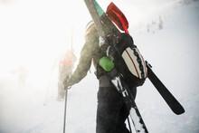Skier Climbing Snowy Mountain ...