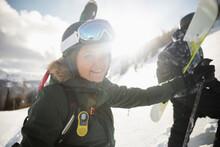 Portrait Happy Female Skier On Sunny Snowy Ski Slope