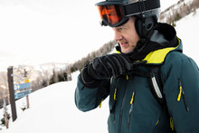 Male Skier Using Walkie Talkie On Ski Slope