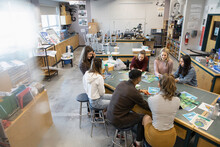 High School Students Working On Recycling Project In Science Classroom