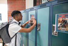 High School Boy Placing Studen...