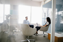 Man And Woman Working In Modern Office