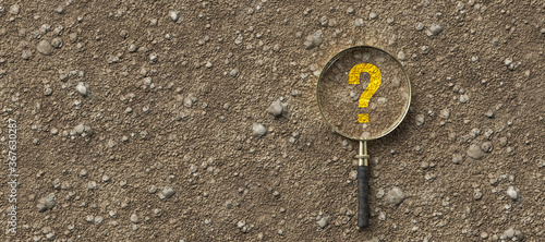 Obraz magnifying glass with question mark on dirt gravel background - fototapety do salonu