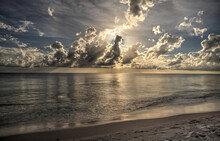 Sun Peeks Through The Clouds O...