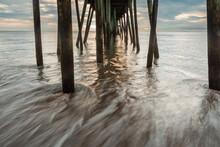 Ocean Waves Crashing Under Pier, Morning At Virginia Beach