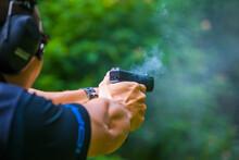 Hand Gun Pistole In A Man Hand