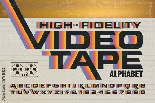 Fotografia, Obraz A Retro Alphabet with 1980s Style Rainbow Effects