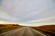 Landscape with road in tundra in Norway at cloudy evening
