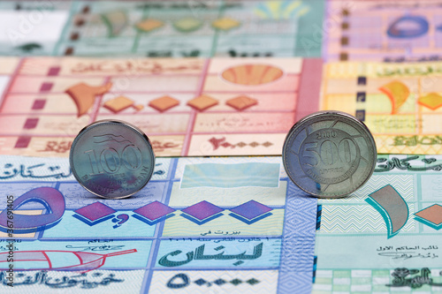 Fotografie, Obraz Lebanese coins on the background of money