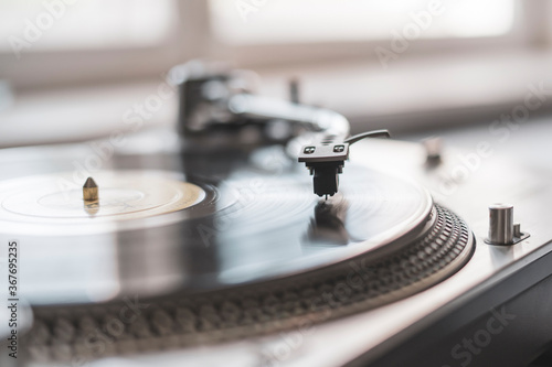 macro close up record player needle playing the vinyl disc, old fashioned retro music player
