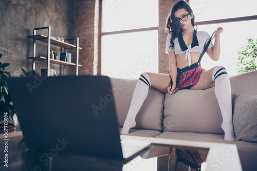 Portrait of her she attractive fit playful flirty alluring nude naked wavy-haired girlfriend on sofa enticing teasing boyfriend using web cam domestic erotica industrial loft interior style apartment - 367706094