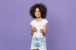 canvas print picture - Smiling little african american kid girl 12-13 years old in white t-shirt isolated on violet background studio portrait. Childhood lifestyle concept. Mock up copy space. Point index fingers on camera.