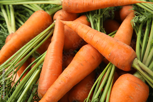Fotografía Fresh ripe carrots as background, closeup view