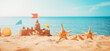 canvas print picture - Sandcastle on the beach at sea in summertime
