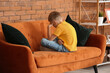 canvas print picture - Sad little boy with autistic disorder at home