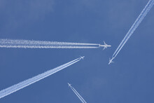 Passenger Planes Crossing With...