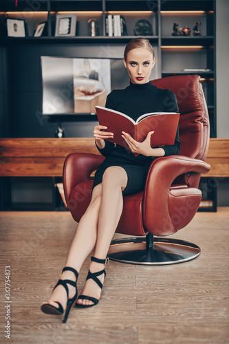 businesswoman reading a magazine