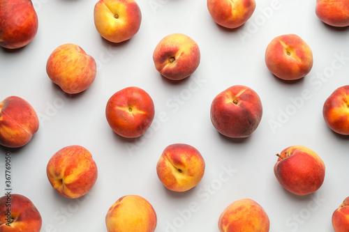 Obraz Many ripe peaches on light background - fototapety do salonu