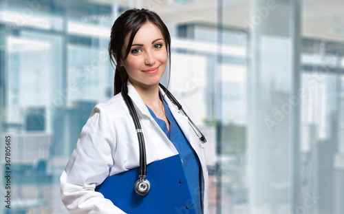 Beautiful female doctor in a modern clinic - 367805685
