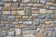 Garten und Landschaftsbau: Hintergrund Mauer Wand aus verputzten und unregelmäßig verlegten Natursteinen