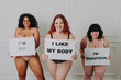 Body acceptance concept.  curvy girl posing in studio against society prejudice