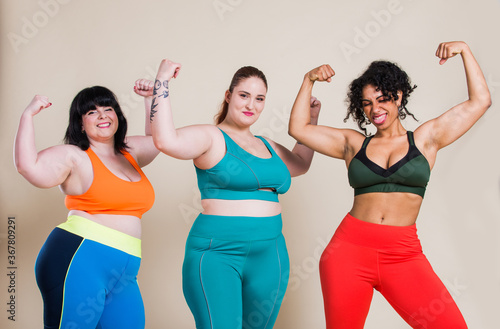 Plus size women making sport and fitness Wallpaper Mural